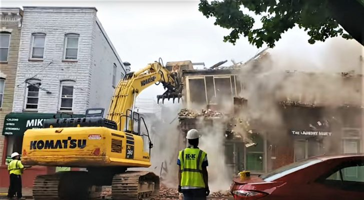 Demolition of a building using a Long Reach Excavator