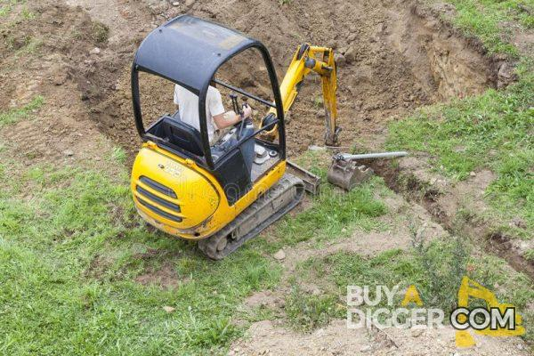 Mini digger digging a swimming pool
